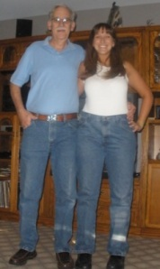 This is me and my dad (who is 7 inches taller than me) wearing his jeans and shoes to show my weirdly long legs.